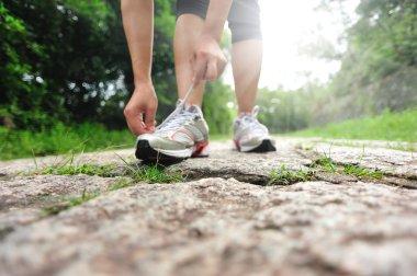 Runner try new running shoes