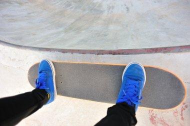 Skateboarding woman legs