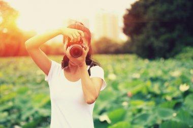 Photographer taking photo of blooming lotus