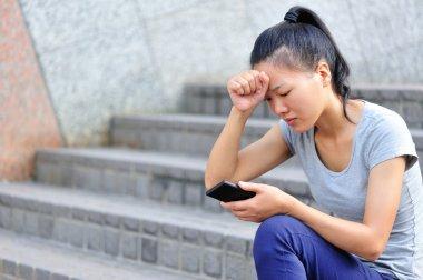Young asian woman got bad news