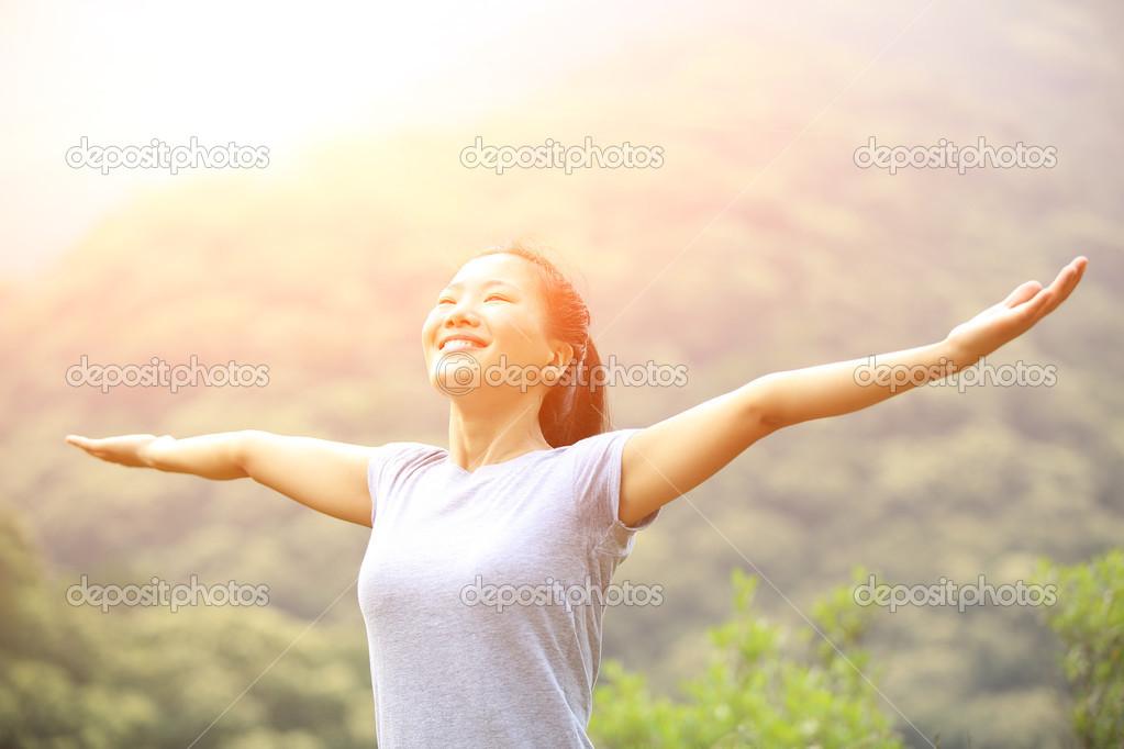 Cheering woman enjoy the beautiful view