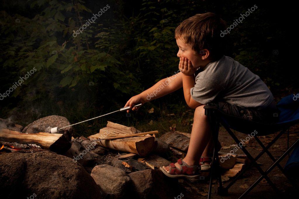 Boy cooking marshmallow