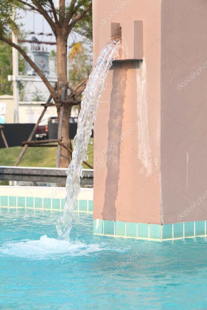 Swimming pool with waterfall jet