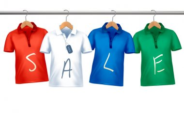 Shirts with price tags hanging on hangers. Concept of discount s