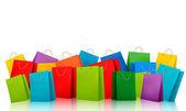 Fotografie Hintergrund mit bunten Einkaufstüten. Rabatt-Konzept. Vektor