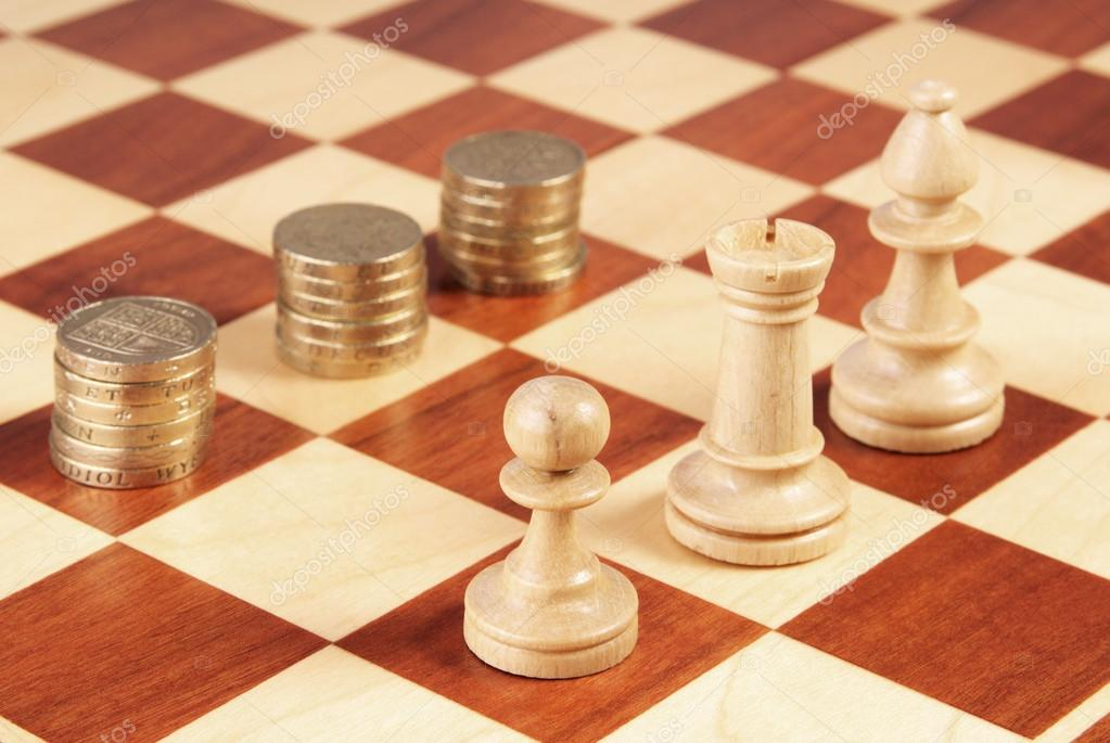 Chess Board With Coins And Chess Pieces Stock Photo C Vetasster