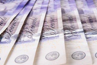 Spread of twenty British Pound notes