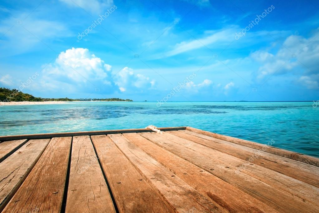 Jetty, beach and jungle - vacation background