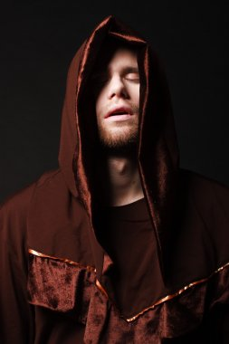 mysterious Catholic monk. studio shot