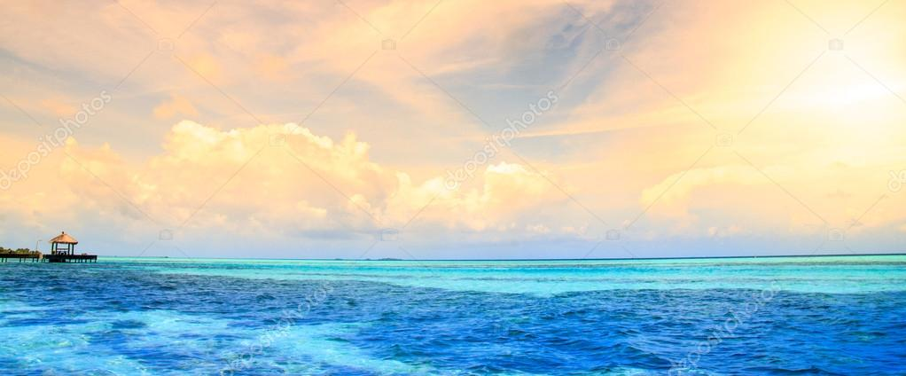 Maldives bungalows sunset panorama