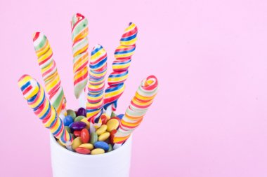 Lollipop and dragee candies