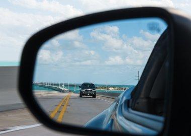 Seven Mile Bridge reflected in car mirror