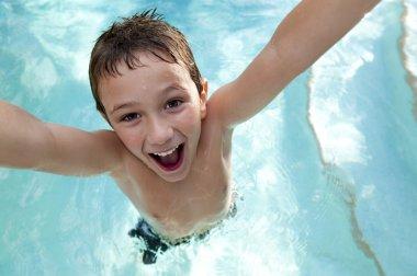 Joyful kid in a swimming pool.