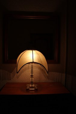 Yellow light of a night lamp in the dark room