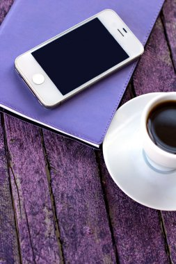 diary, mobile phone and a cup of coffee