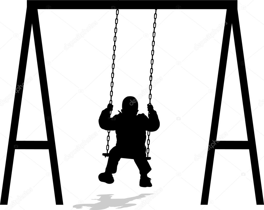 Boy swinging at the park in winter jacket