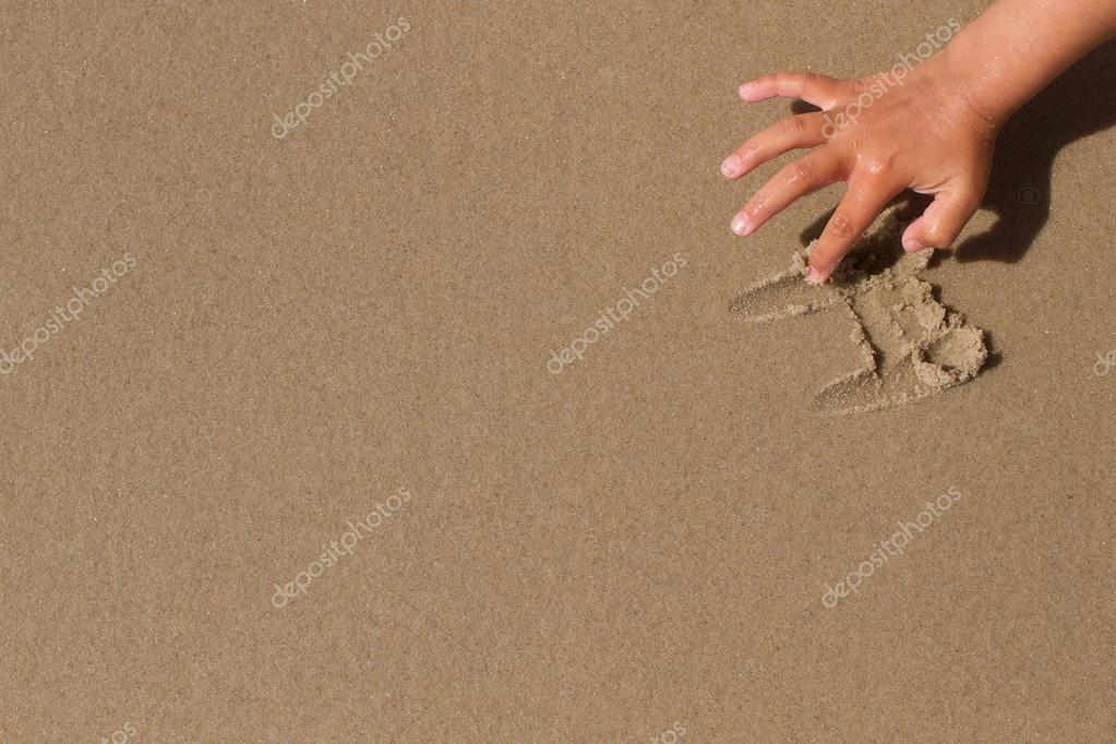 Hand drawing in the sand