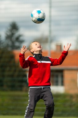 Boy heading to his soccer ball