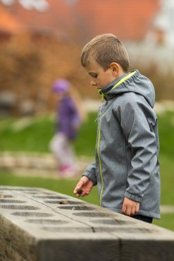 Boy counting stones