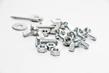 Nuts, screw, wing nut, flat washers on a white background