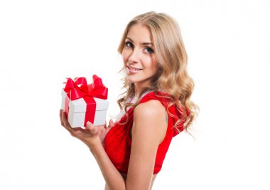 Happy smiling woman in santa claus clothes with present box. Concept - winter, christmas, x-mas, new year