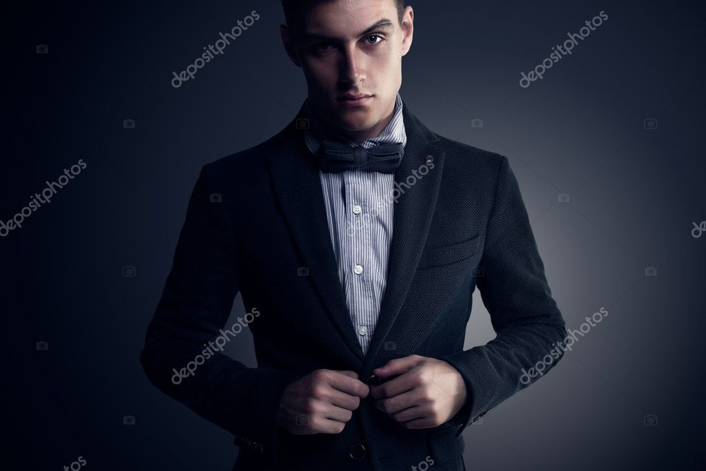 3f57255b108b Portrait of attractive handsome stylish fashion young man in elegant casual  classical suit with bow tie