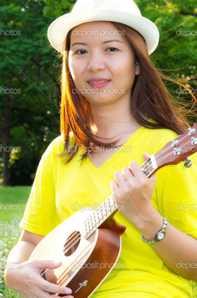 Asia beauty woman play ukulele in the park — Photo by ...