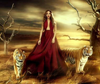 Woman in the desert tigers near her