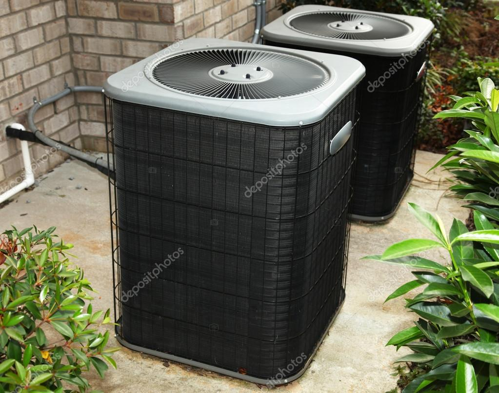 Residential Cental Air Conditioning Units On Cement Slab
