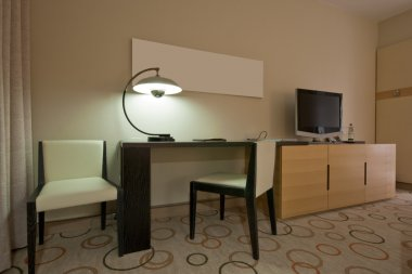 Study room with writing desk and tv set