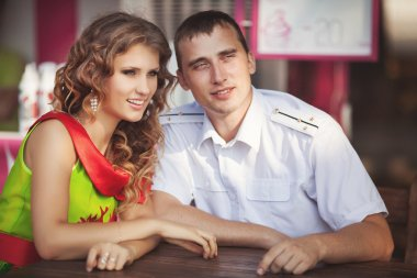 happy teenage couple in love at restaurant