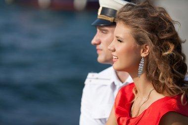 military seaman and his girlfriend near sea