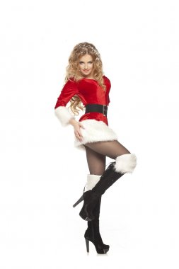 Beautiful christmas woman in Santa Clause costume with extra long curly hair.