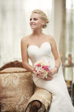 Bride in wedding dress in luxury interior