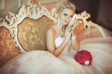 Bride in wedding dress with diamond jewelry