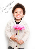 Fotografie Child with big smile and big pink flower with I love mum message
