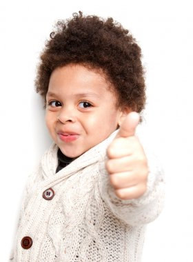 Cute child doing thumbs up sign