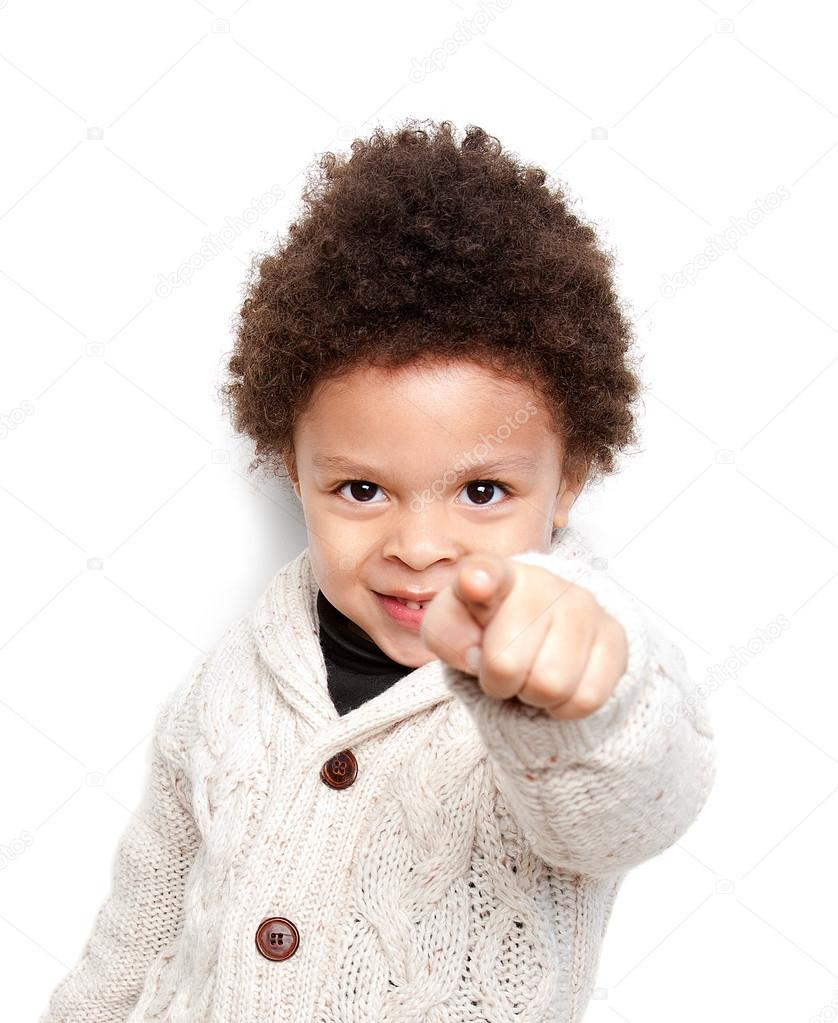 Cute child smiling and pointing at you