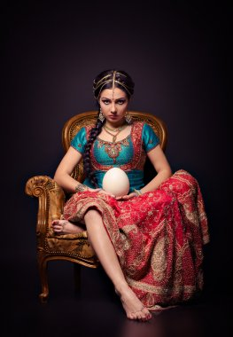 A beautiful Indian princess in national dress and egg