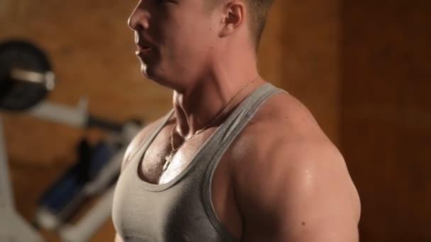 Healthy muscular young man posing in studio