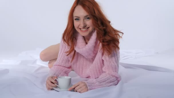 Girl drinking coffee on the bed
