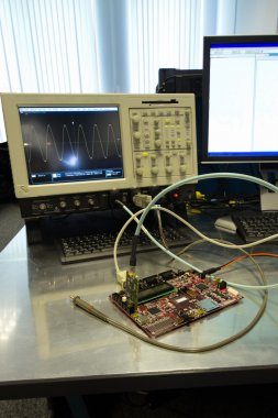 Electronic circuit board connected to an Oscilloscope