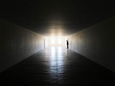 A man standing in dark room
