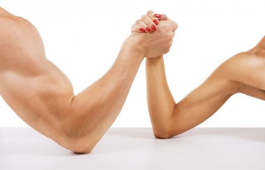 A man and woman with hands clasped arm wrestling, isolated on wh