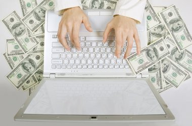 Paid job: Female hands typing on white computer keyboard