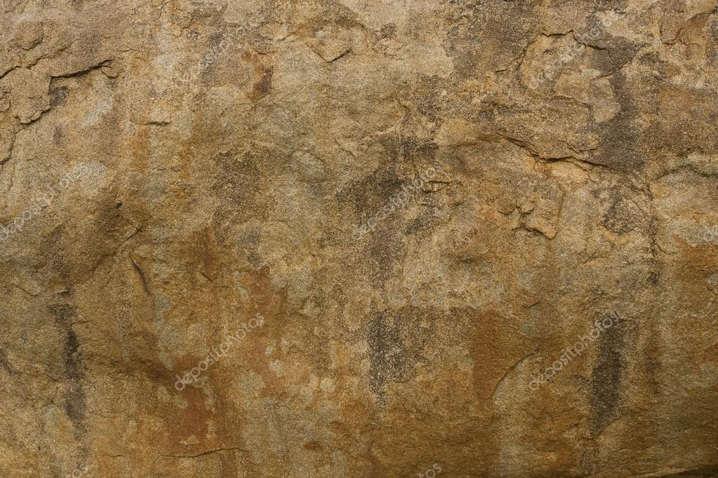 Brown rock texture. Stone background