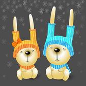 zwei Weihnachtshasen in Hüten.