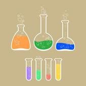 Vektor-Illustration von Laborgeräten mit bunter Lösung.