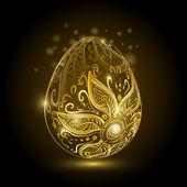 Goldenes Osterei mit Blumenschmuck.