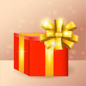 Vector red gift box with golden ribbon and bow